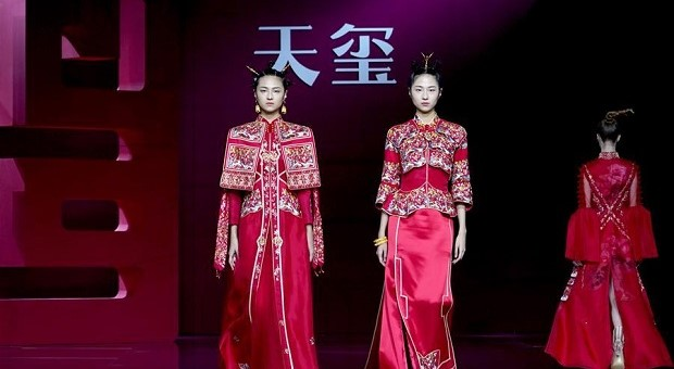 Models present creations by Tia Su during China Fashion Week